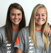 Central York High girls' soccer rising seniors and best friends, Chloe Carns, left and Maddie Davis, pose for a photo at Fall Sports Media Day. Davis and Carns are committed to play together at NCAA Division II Bloomsburg University.