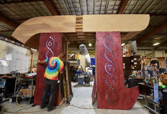 Artist Scott Fraleigh works on the Archway of Pi, the entryway into The Key Bearer Project under construction at The Generator. The project will be on the playa at Burning Man 2019.