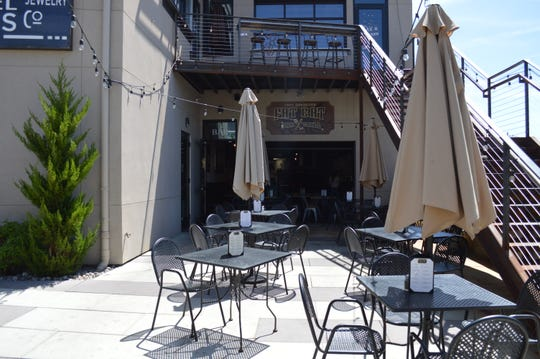 The new Fat Cat Bar & Grill in Midtown Reno includes a rear patio that lies just off the parking lot for the building.