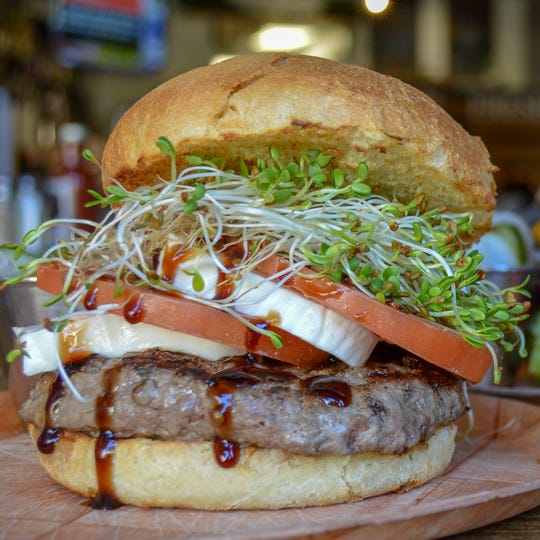 The Caprese burger and other burgers at the new Fat Cat Bar & Grill in Midtown Reno feature grass-fed beef patties from local Bently Ranch.