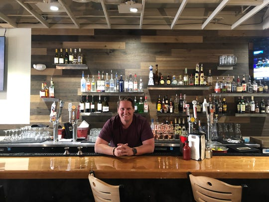 Clint Peetz, owner of the original Fat Cat Bar & Grill in Tahoe City, takes a moment in the new Fat Cat he opened in late May 2019 in Midtown Reno.