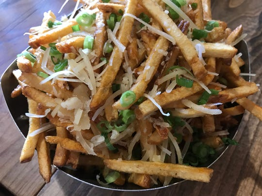 At the new Fat Cat Bar & Grill in Midtown Reno, french fries are made in house. Here, a heap of garlic Parmesan fries.