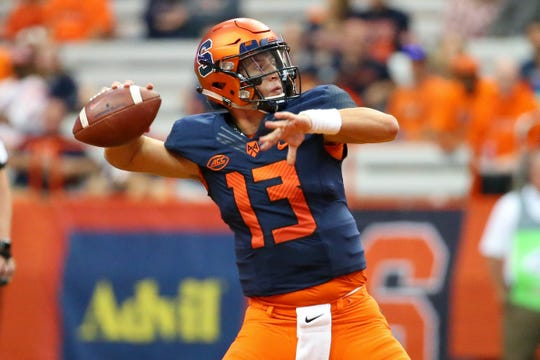 Syracuse Orange quarterback Tommy DeVito (13) passes the ball against the Wagner Seahawks during the third quarter of the 2018 home opener at the Carrier Dome.
