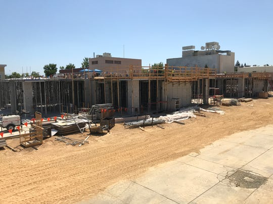 Rising from the ground is the four-story Market Center in downtown Redding on Friday, Aug. 2, 2019.