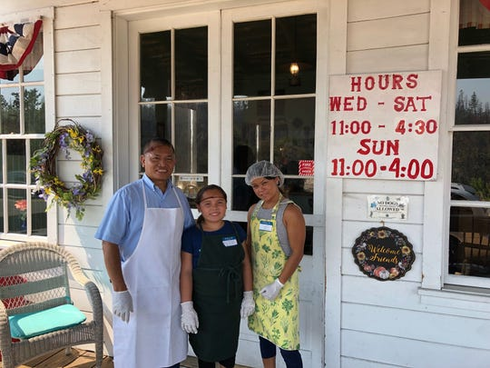 Rollie and Nella Cadungon, left, and JoJo Tomaroy on the porch at Shorty's Eatery in Shasta.