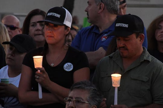 People lit candles and proudly bore the #GILROYSTRONG emblem at Thursday's vigil. August 1, 2019.