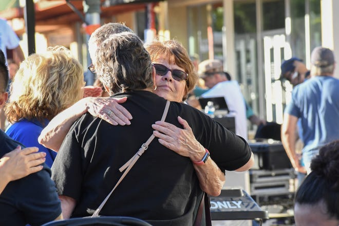 Photos from the candlelit vigil Thursday evening in downtown Gilroy.