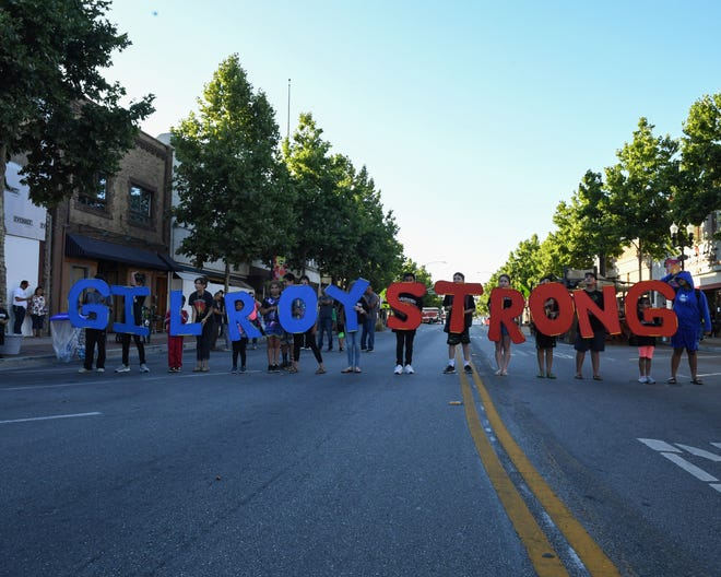 """Children hold up the emblem """"GILROYSTRONG"""" in the downtown of Gilroy. August 1, 2019."""