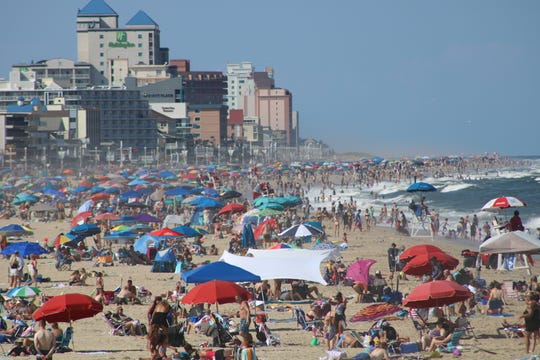 Beachgoers enjoy the beach and surf in Ocean City on Aug. 24.