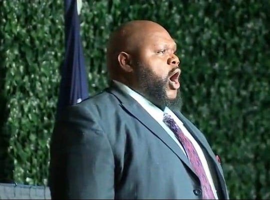 Larry Jay Giddens Jr. sings the National Anthem at the Jamestown 400th Anniversary commemoration on Tuesday, July 30, 2019 in Jamestown, Virginia.