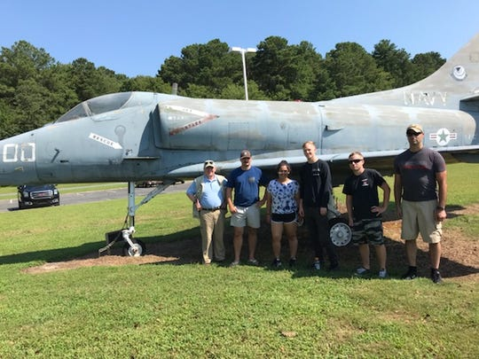 A vintage Navy airplane on display at the Accomack County Airport in Melfa, Virginia is getting a facelift, thanks to a crew from the VFC-12 squadron at Naval Air Station Oceana.