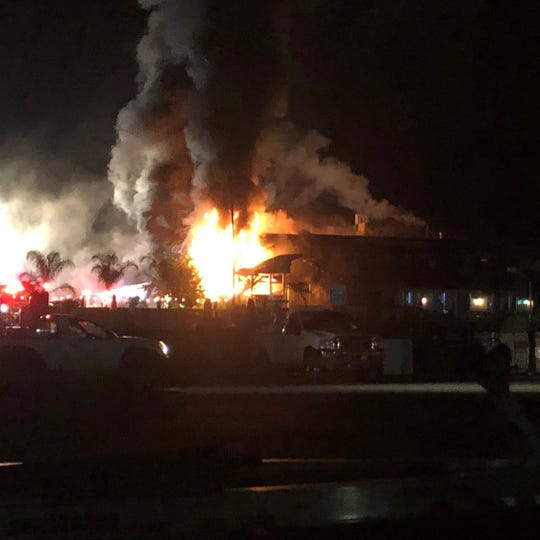 Mad Fish Bar & Grill was engulfed in flames early Friday morning. The fire was extinguished around 7:18 a.m.