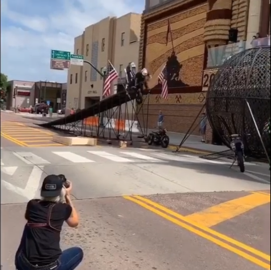 Cole Freeman crashes his motorcycle in front of the Corn Palace in Mitchell.