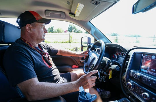 Doug Boswell, 54, drives his truck using hand controls for the throttle and brakes on his farm north of Stockton on Tuesday, July 30, 2019.