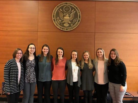 Plaintiffs Maria Hauer (from left), Kaitlyn Babich, Jill Kedrowski, Haley Bock, Kiersten Rohde, Anna Lindell, Alexie Portz and Fernanda Santos pose for a photo at the U.S. District Court building.