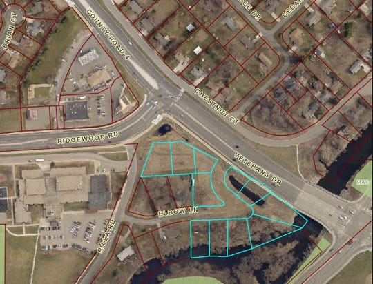 An aerial image shows where a developer is proposing a commercial development near Veterans Drive and Stearns County Road 134 in St. Cloud.