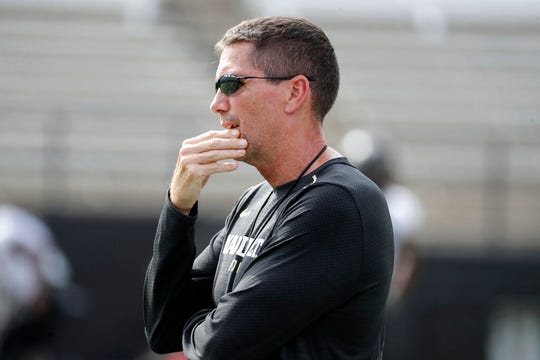 FILE - In this Aug. 16, 2018, file photo, then-Vanderbilt offensive coordinator Andy Ludwig watches during an NCAA college football practice in Nashville, Tenn. Ludwig is back as offensive coordinator at Utah with an evolving playbook. Utah's players are embracing Ludwig's offense with enthusiasm. It is a bit slower and features more huddles between plays than what they've run in the past. Still, they are seeing and absorbing aspects of the game in a whole new way.(AP Photo/Mark Humphrey, File)