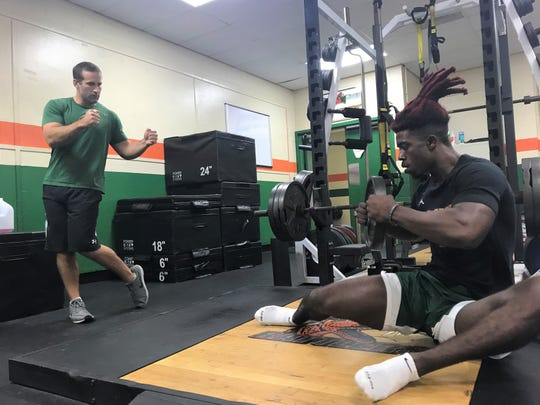FAMU strength and conditioning coach Parker Brooks works out with wide receiver Chad Hunter on his  functional range conditioning.