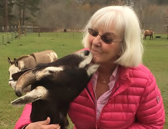"""VieVie Baird has written a book called """"We Are Friends: Stories from Frog Song Farm Sanctuary,"""" to benefit the sanctuary."""