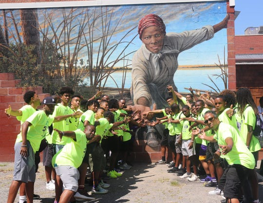 The Omega Lamplighters traveled to Cambridge, Maryland, to visit the Harriet Tubman mural created by Florida State University graduate Michael Rosato.