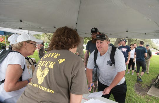 Michelle Dale, left, and Patty Ryan register participants for the Ruck for Our Veterans march on June 29, 2019. The registration fee for many veterans was covered by local donors and businesses, allowing them to enjoy the ruck for free.