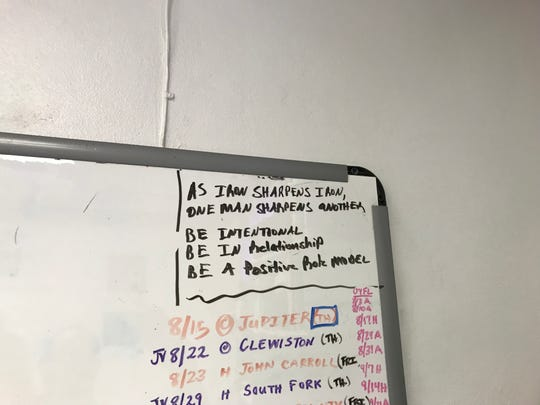 Messages written on the corner of a dry erase board in Okeechobee football coach Ty Smith's office.