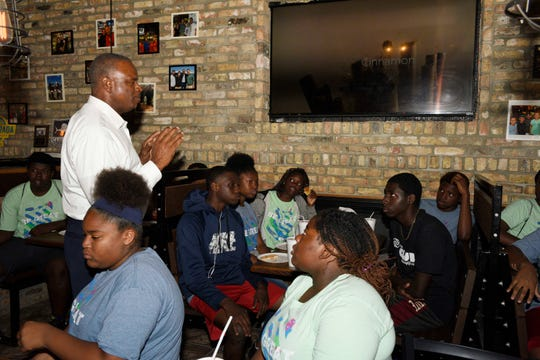 Former State Rep. Larry Lee Jr. talks career advice to teenagers from the Boys & Girls Clubs of St. Lucie County's Percy Peek location during a visit to Big Apple Pizza in Fort Pierce.