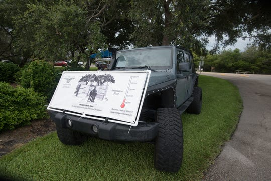 The Jeep is often associated with military culture. This one displays a banner of the Words From War monument to be built near Vero Beach's Riverside Park, at the entrance to the Veterans Memorial Island Sanctuary.