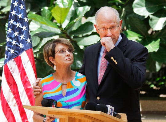 In this Wednesday, July 31, 2019, photo, U.S. Rep. Mike Conaway, R-Texas, gets a little emotional as he stands next to his wife, Suzanne Kidwell Conaway, during a news conference in Midland, Texas, where he announced plans to retire, saying he will not seek reelection in 2020.