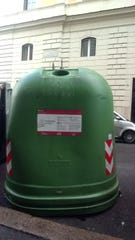 This dome container in a European street is used to collect glass for recycling.