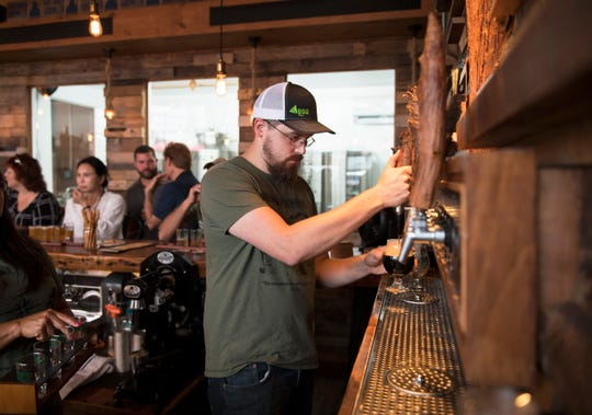 Head brewer Nick McMillen pours a beer at Core 3 Brewery in Clayton on Friday, August 2, 2019.