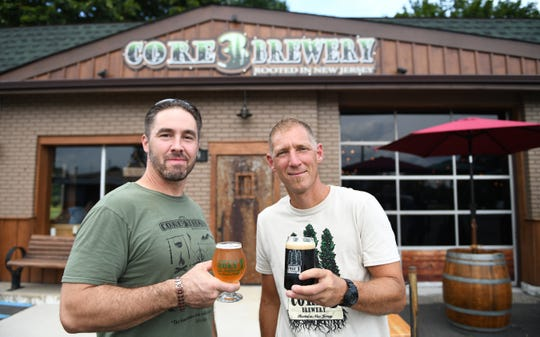 Lawrence Price, left, and Alexi Skriapas, co-owners of  Core 3 Brewery in Clayton, stand in front of their brewery as they celebrate its grand opening on Friday, August 2, 2019.