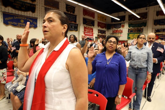 New citizens take the Oath of Allegiance during a naturalization ceremony at the Rockland County Fire Training Center in Pomona Aug. 2, 2019. Rockland welcomed 135 new citizens from 40 countries.
