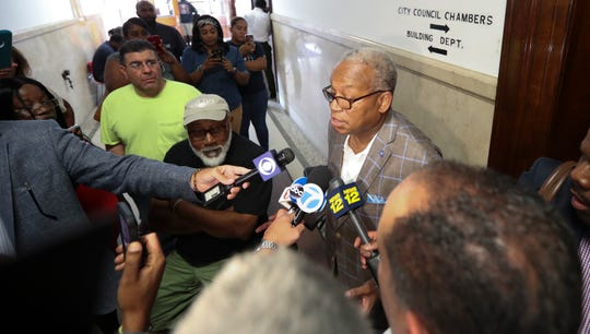 Reggie Lafayette, right, comments to the press outside the city council chambers about the election of Lisa Copeland as Council President in a move to remove acting Mayor Andre Walace during a city council meeting in Mount Vernon on Friday, August 2, 2019.