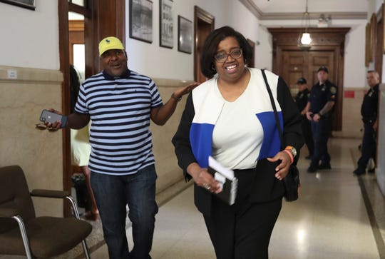 Mount Vernon City Council President Lisa Copeland, right, is heckled by resident Sam Rivers outside the council office after she was elected president during a council meeting on Friday, August 2, 2019.