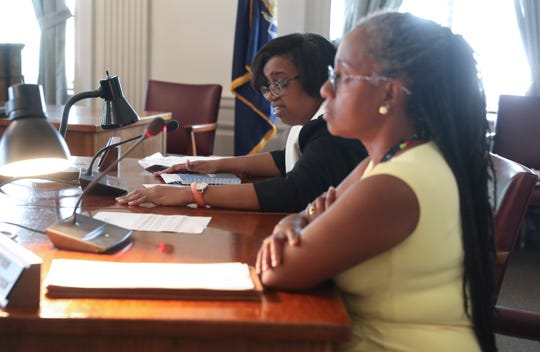 City council member Lisa Copeland, back, makes comments during a city council meeting in Mount Vernon on Friday, August 2, 2019.