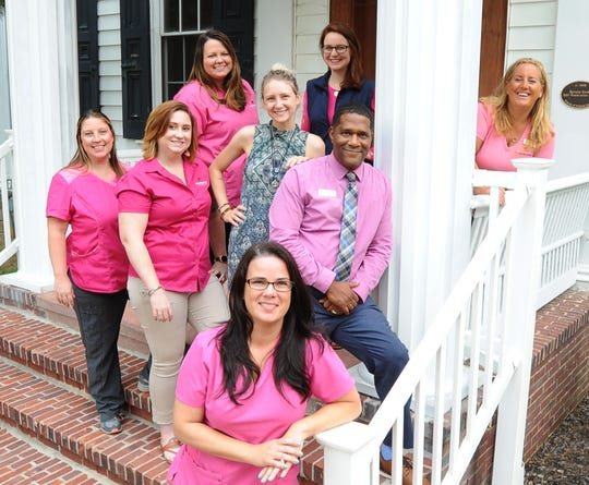 WIL NURSE NEXT DOOR -  Allison Brooks, (right) Executive director of Nurse Next Door with some of her staff at their office on Main St. in Camden.  Nurse Next Door is one of the winners for medium size Top Workplace award.   GARY EMEIGH /Special To The News Journal