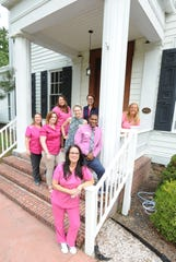 Allison Brooks, (right) Executive director of Nurse Next Door with some of her staff at their office on Main Street in Camden.
