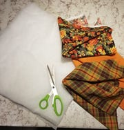 """Unroll your quilting batting and using your scissors, cut a square about 18""""x18"""". This may need to be a little larger or a little smaller, depending on the size of your roll of tissue."""