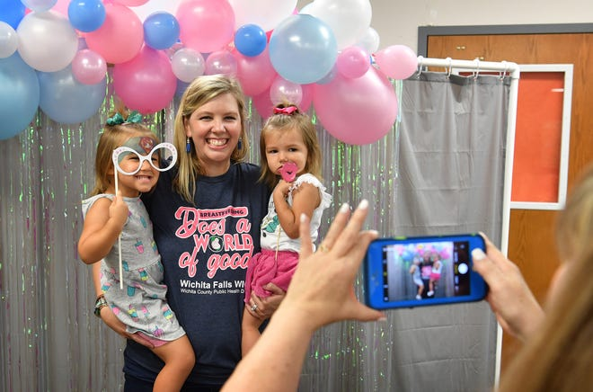 Mehgan White, a nutritionist for the Wichita Falls Women, Infants and Children (WIC) program is photographed with her kids, Lynnly, left, and Emma at an event celebrating National Breastfeeding Month as shown in this Aug. 2, 2019, file photo. Texas WIC is expanding options for eligible food effective immediately amid the COVID-19 pandemic.