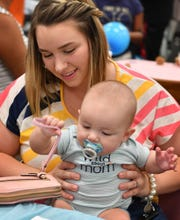 """In this file photo, Dallas Grubbs and her son, Hudson Grubbs, 6-months, participated in the Wichita Falls Women, Infants and Children (WIC) Breastfeeding Event. Texas received a """"D"""" rating from the March of Dimes for maternal and infant health."""