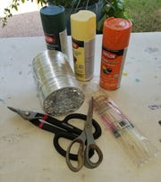 Materials needed to make an Air Duct Pumpkin include: Dryer vent duct, scissors, wire cutters or pliers, small zip ties and spray paint in your choice of colors.