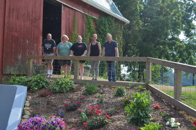 From left, Duane, Kris, and Lindsey Byrne, Andrea Noble, and Jim Byrne are eager to share their revamped Pheasant Valley Barn with the public and have dubbed it the venue with a view.