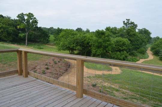 A deck attached to Pheasant Valley Barn looks out over Pheasant Valley and walking paths.
