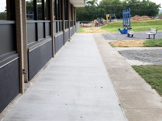 New sidewalks and a continuous ramp outside the building are part of the $2.6 million project that will transform Starlight school and its former workshop for the students and facility.