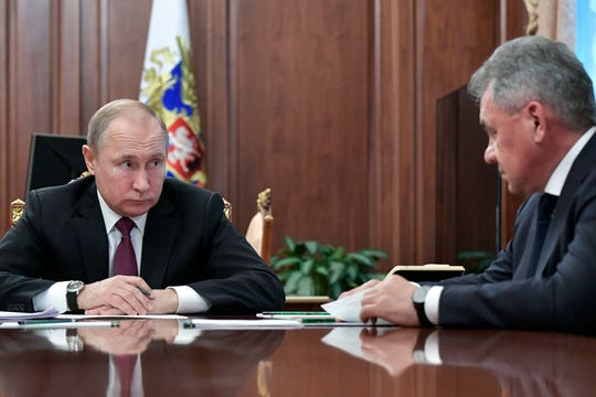 In this Feb. 2, 2019, file photo, Russian President Vladimir Putin, left, speaks to Defense Minister Sergei Shoigu during a meeting in the Kremlin in Moscow, Russia.