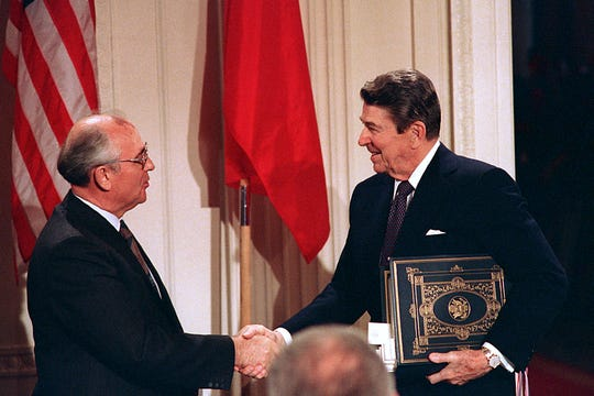 FILE - In this Dec. 8, 1987, file photo, President Ronald Reagan, right, shakes hands with Soviet leader Mikhail Gorbachev after the two leaders signed the Intermediate Range Nuclear Forces Treaty to eliminate intermediate-range missiles during a ceremony in the White House East Room in Washington. The landmark arms control treaty that Reagan and Gorbachev signed three decades ago is dead. The U.S. and Russia both walked away from the deal on Friday, Aug. 2, 2019. (AP Photo/Bob Daugherty, File)