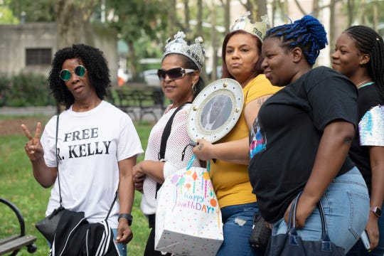 Supporters of R. Kelly arrive at federal court in Brooklyn for his arraignment on sex-crime charges on Aug. 2, 2019, in New York.