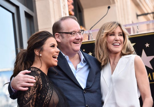 Eva Longoria, Marc Cherry and Felicity Huffman attend a ceremony honoring Eva Longoria with the 2,634th Star on the Hollywood Walk of Fame on April 16, 2018.