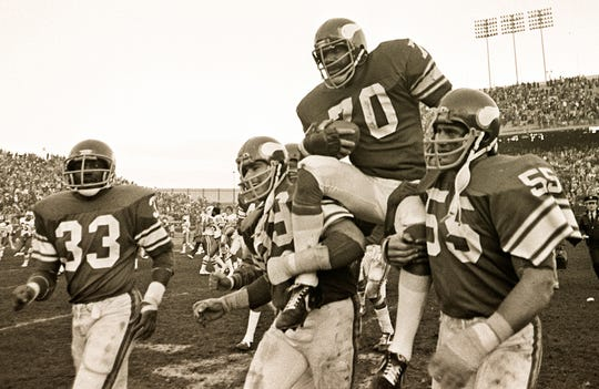 Jim Marshall (70) is carried off the field after his final home game.